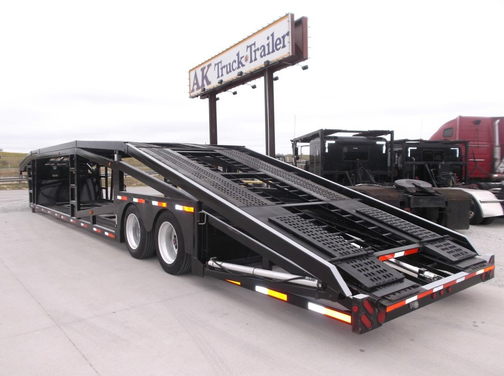 Black Semi with Car Haulter